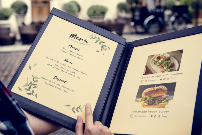 Guest Browsing a Beautiful Restaurant Menu